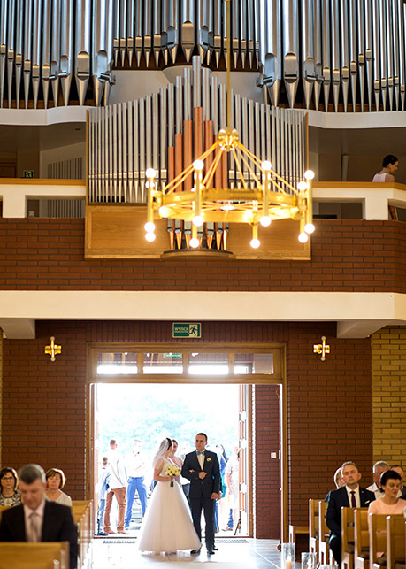 Bride and Groom during Wedding Ceremony St. Lucas Church, Radom